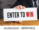 enter to win  message on white... | Shutterstock . vector #380002816