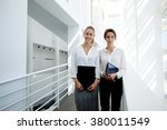 team of young businesswomen... | Shutterstock . vector #380011549