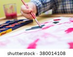 small child painting with... | Shutterstock . vector #380014108