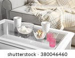 low table with sweets and two... | Shutterstock . vector #380046460