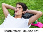 young male skater resting on... | Shutterstock . vector #380055424