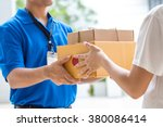 Small photo of Woman hand accepting a delivery of boxes from deliveryman
