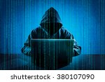 Hacker using laptop. Hacking the Internet. - stock photo