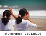 two asian women with praying... | Shutterstock . vector #380128108