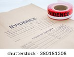 Small photo of evidence bag with red evidence sealing tape for crime scene investigation