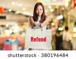 """"""" refund """" text on bag hold by... 