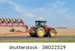 Two Tractors With  Ploughs  ...