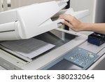 woman opening a photocopier | Shutterstock . vector #380232064