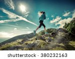 Female Running In Mountains...