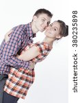 beautiful woman and boy cuddling | Shutterstock . vector #380235898