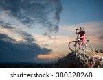 cross country biker drinking... | Shutterstock . vector #380328268