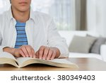 blind boy reading a braille book | Shutterstock . vector #380349403
