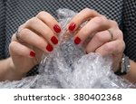 female hands popping the... | Shutterstock . vector #380402368