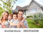 happy family near new house. | Shutterstock . vector #380456008
