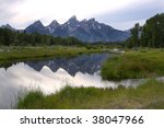 The beautiful Grand Tetons Mountain range reflected in the Snake river - stock photo