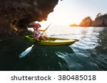 lady paddling kayak in the... | Shutterstock . vector #380485018