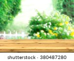 empty wood table top for... | Shutterstock . vector #380487280
