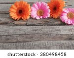 Gerbera Flowers On Wooden...