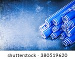blue rolled construction plans... | Shutterstock . vector #380519620