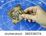 hand holding a card with sign... | Shutterstock . vector #380538376