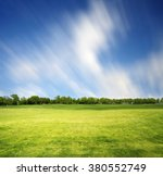 meadow with green spring grass. ...   Shutterstock . vector #380552749