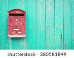 Red Mailbox With Green Wood...