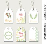 set of floral gift tags. vector ... | Shutterstock .eps vector #380584579
