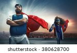 Stock photo funny portrait of two antagonistic super heroes 380628700
