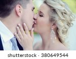 wedding couple on the nature is ... | Shutterstock . vector #380649544