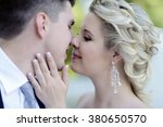 wedding couple on the nature is ... | Shutterstock . vector #380650570
