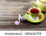 cup of tea with tea bags and... | Shutterstock . vector #380656759