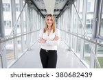 businesswoman standing in a... | Shutterstock . vector #380682439