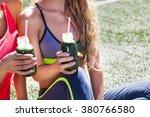 Two Happy Women Drinking...