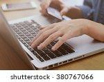 woman's hands holding credit... | Shutterstock . vector #380767066