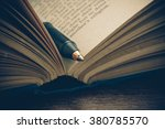 pen and book with filter effect ... | Shutterstock . vector #380785570