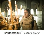 Young Female Lighting Candles...