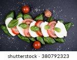 fresh italian caprese salad... | Shutterstock . vector #380792323