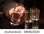 shot glasses of vodka in hand ... | Shutterstock . vector #380822020