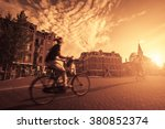 riding a bike in the city  | Shutterstock . vector #380852374