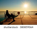 Man Sit On Bench On Wharf...