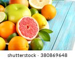 Citrus Fruits On A Blue Wooden...