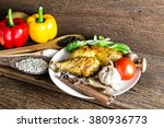 roasted chicken on wooden table | Shutterstock . vector #380936773
