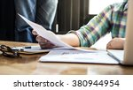 handsome man working with... | Shutterstock . vector #380944954