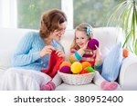 mother and daughter knitting... | Shutterstock . vector #380952400