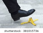 business man stepping on banana ... | Shutterstock . vector #381015736