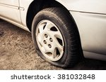 Small photo of Close up Flat tire and old car on the road waiting for repair