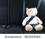plush toy cat strapped in with... | Shutterstock . vector #381043564