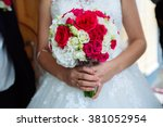 wedding bouquet in brides hands | Shutterstock . vector #381052954