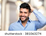 portrait of a man touching his... | Shutterstock . vector #381063274