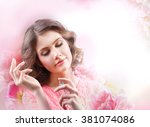 beautiful woman with perfume... | Shutterstock . vector #381074086
